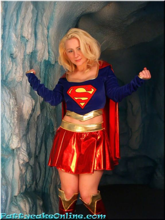 Busty teen girl dressed in superwoman uniform