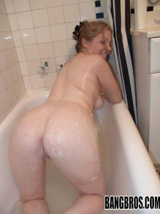 Young blonde lathered up in the shower