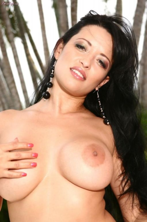Brunette Mason Storm shows her enormous boobs