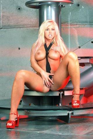 Brittney Skye shoving in a red dildo