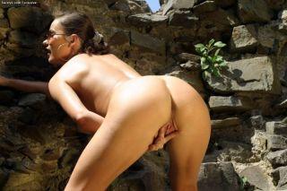 Sexy brunette Kyla Cole posing outdoors