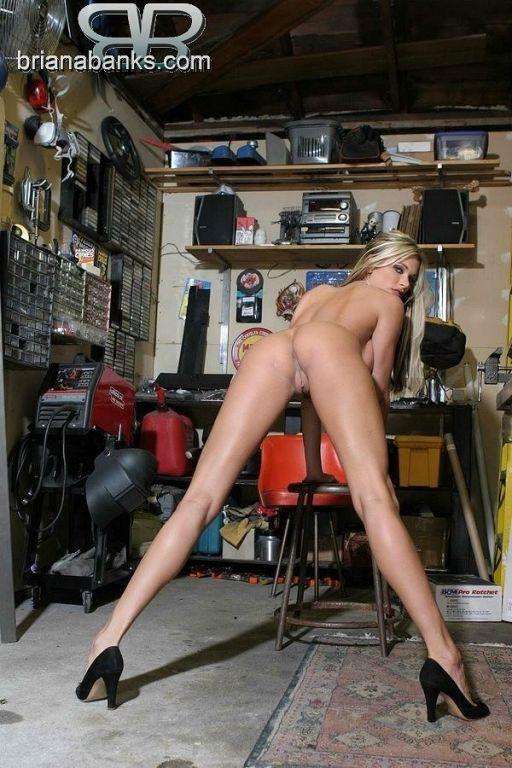 Briana Banks posing naked in a garage