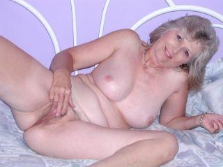 Sexy hairy granny strips naked and masturbates dur