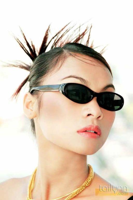 Glamour Thai model Tailynn poses outdoors