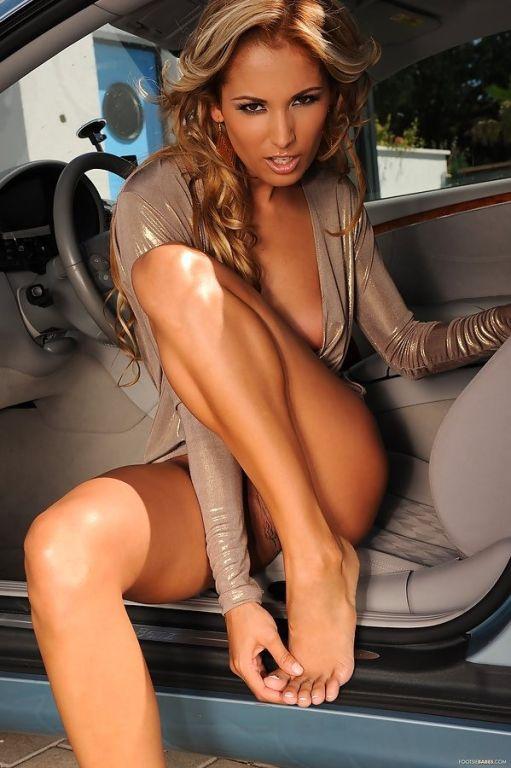 pretty long legged blonde in high heels strips nak