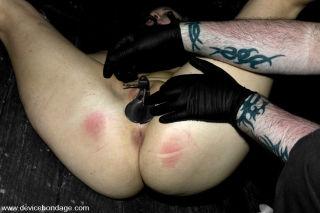 Raina Verene suffers through a punishing BDSM gaun