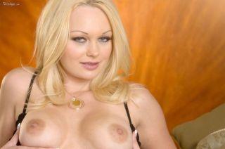Blonde Martina Warren showing off her body on bed