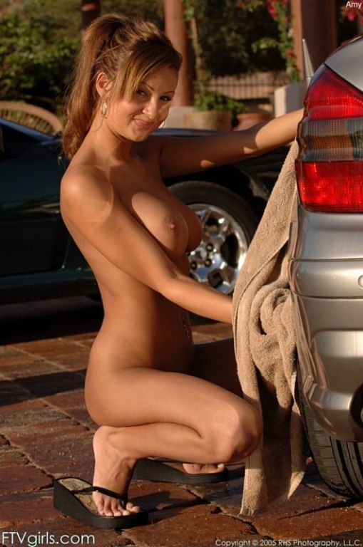 Stunning Amy Reid washing a car in her bikini
