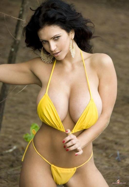 Denise Milani posing in a yellow bikini