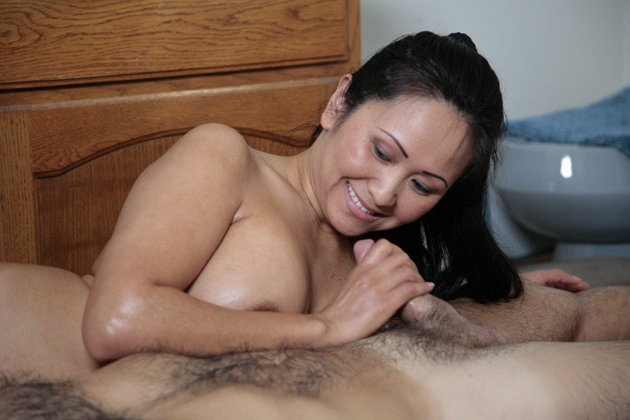 sexy mature asian gives soapy handjob on the air mat