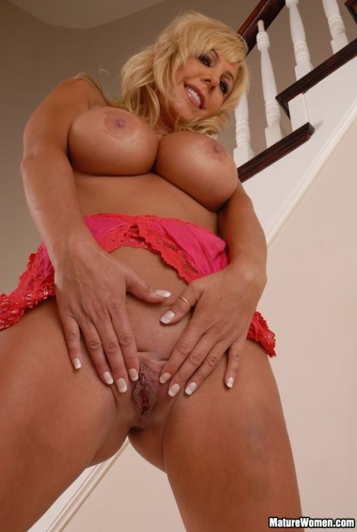 Busty blonde cougar shows off her tits and ass