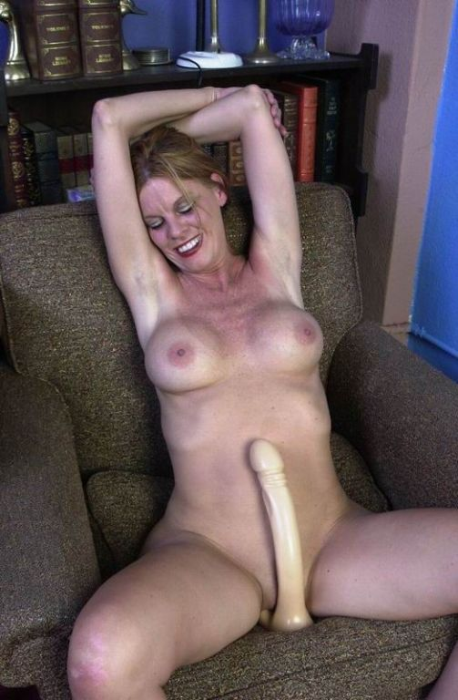 Busty granny toying herself