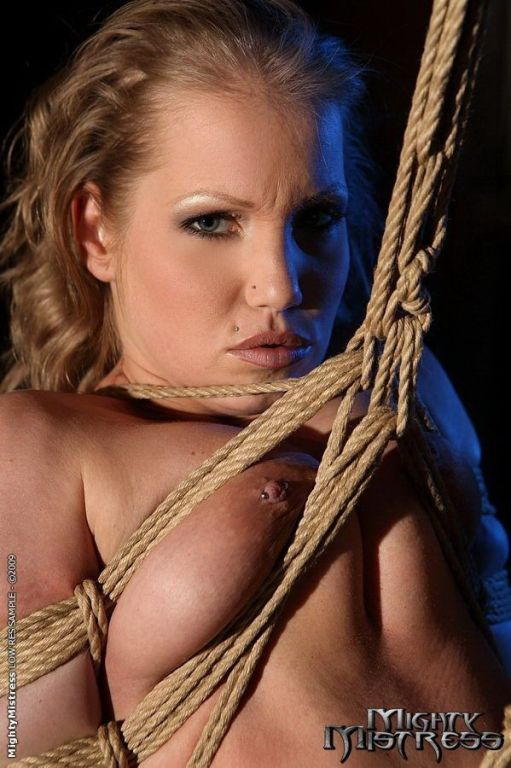 Mandy Bright dominating her slave