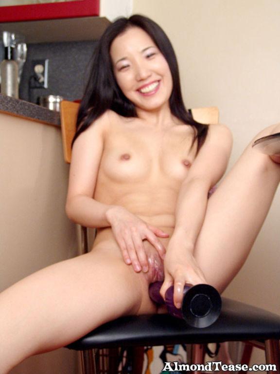 Almond having fun with her purple dildo