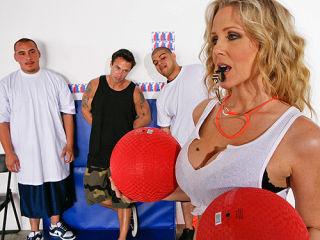 Julia Ann sucks on a students big hard cock