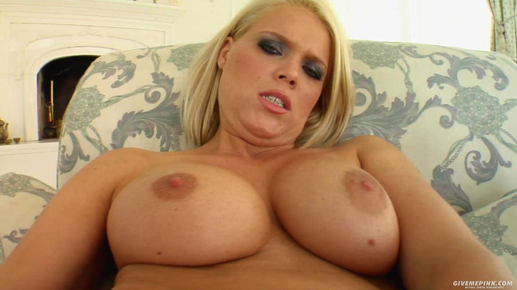 Blonde stuffs a huge pink vibrator in her wet puss