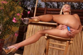 Busty blonde Gitta Szoke playing with her vibrator