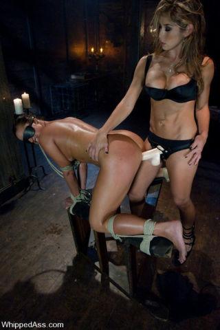 Fiesty domme flogging her slut slave