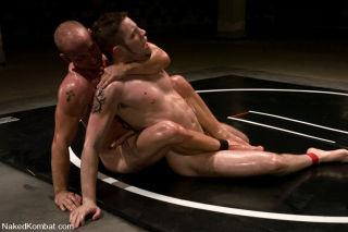 Patrick Rouge and Wolf Hudson body slam, then slam