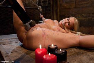 Hogtied and naked Mellanie Monroe in hard bondage