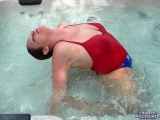 Hard nipple brunette stripping in a hottub