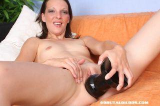 Alizia pounds two giant dildos