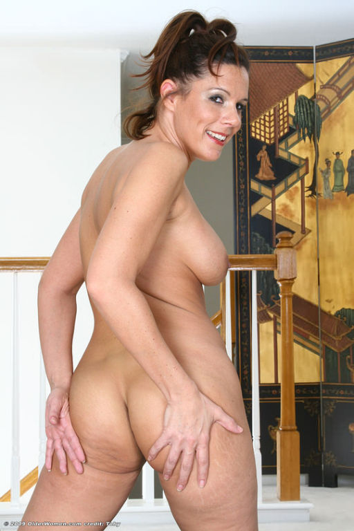 Busty athletic MILF stripping and bouncing naked o