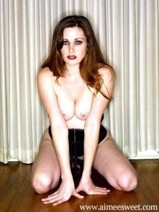 Aimee Sweet in tight bondage corsett