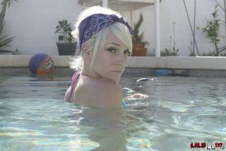 Lily Luvs posing in bikini outdoors