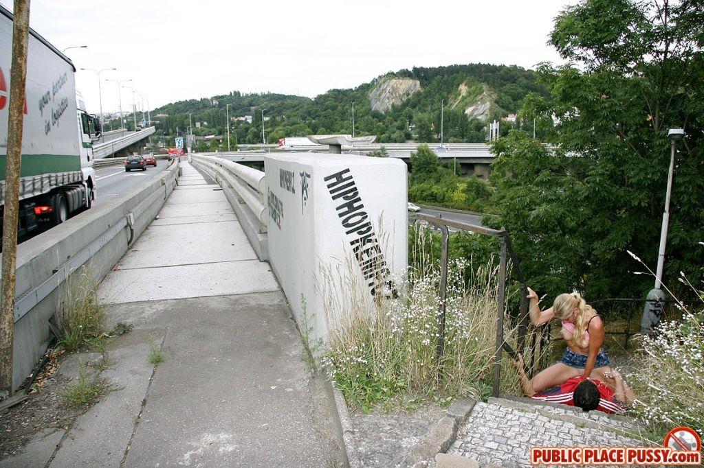 Blonde girl is having naughty sex near the highway