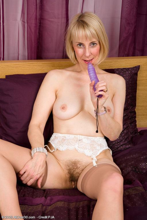 63 year old Hazel pulls her panties aside to displ