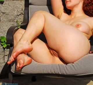 Fullbush beauty sunbathing nude hairy pussy and pi