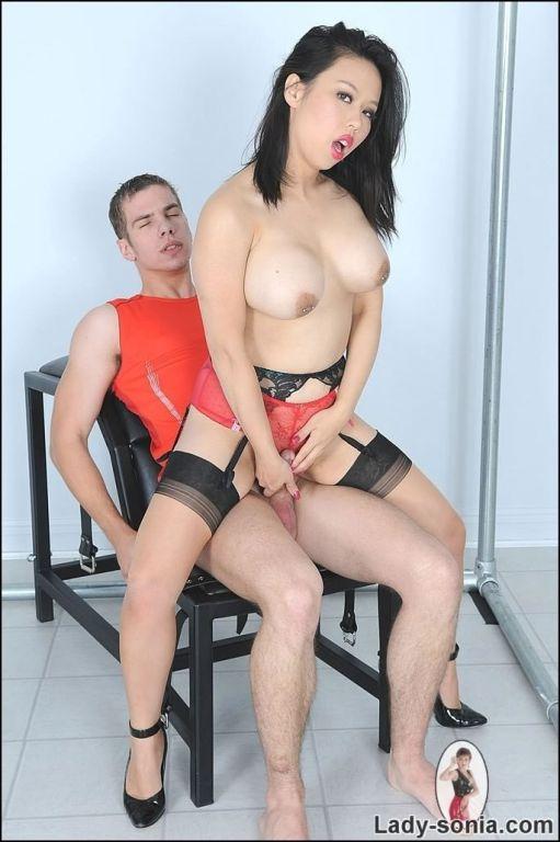 Busty asian slut in stockings milking cock