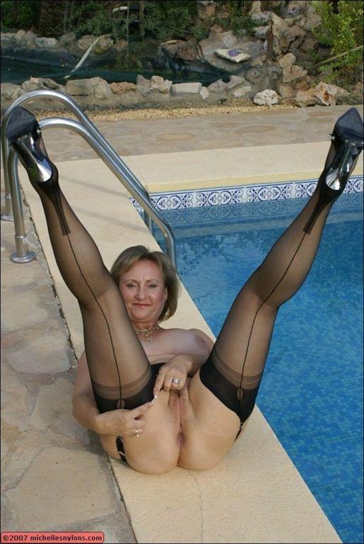 Leggy nylon model Micchelle spreading by the pool