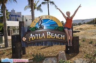 Tiny blonde bikini teen at the beach