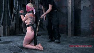 Bondaged blonde in extreme action
