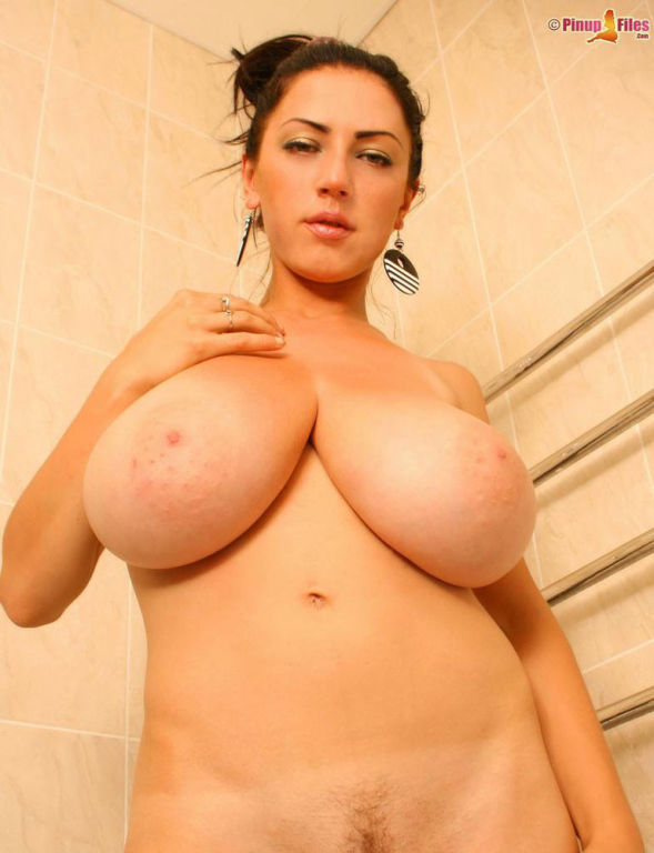 Busty Merilyn strips off her black and white top