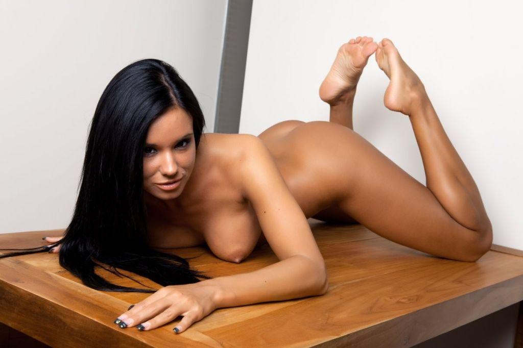 Ashley Bulgari tanned brunette in leopard dress