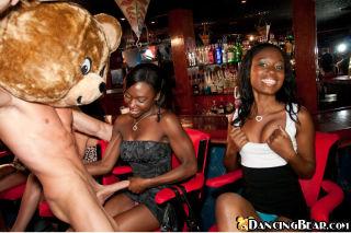 Amateur girls sucking the bear's big cock at a bir