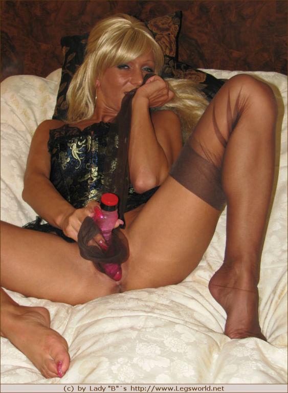 Blonde Ewa having phonesex in brown stockings