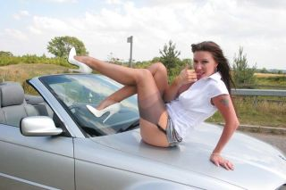 Leggy Saffy in stockings and heels outdoors