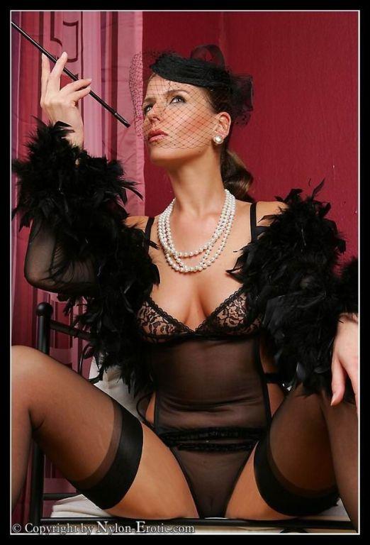 Glamour babe in stockings smoking