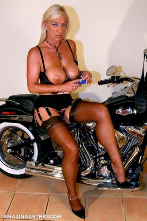 Smoking Astrid on a bike wearing stockings