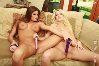 Cute lesbian babes playing with sex toys and havin
