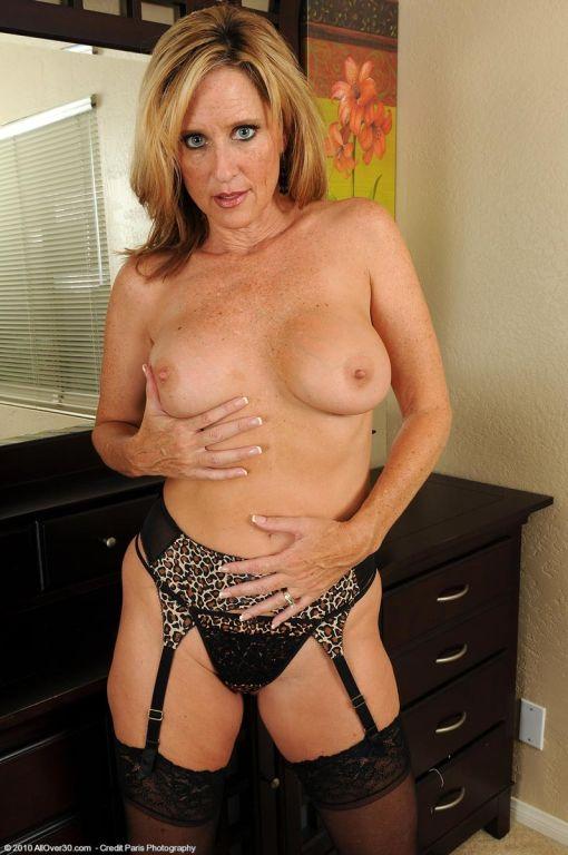 Hot big breasted milf posing in lingerie