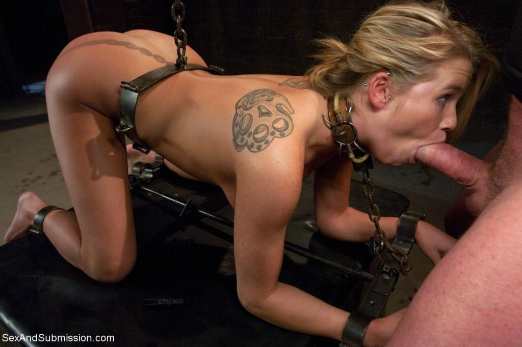 Babe gets fucked hard in steel restraints and rope
