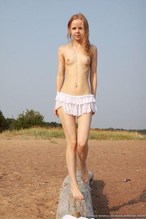 Tiny teen girl naked outdoors