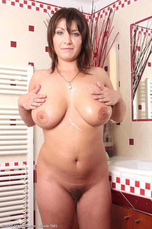 Sexy Sophia rubs cream on her large titties