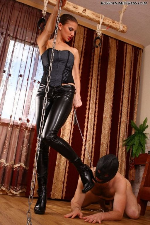 Irresistible lady lashing poor slave and then orde