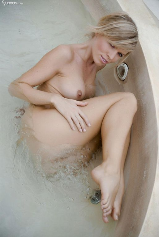 Hot blonde babe having fun in a jacuzzi